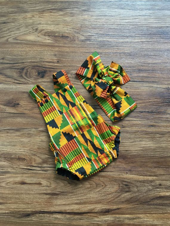 African inspired Kente print baby romper. This fully lined bodice romper has low…