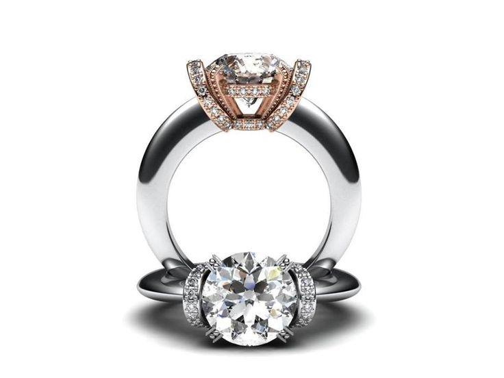 Luxusní prsten s dominantním 2 ct. kamenem a menšími kameny po stranách korunky. Korunku je možné vyrobit z bílého, červeného nebo žlutého zlata.   www.korbicka.com