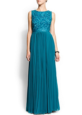 Sleeveless gown dress with a sequin body, round neck and pleated skirt.   by Mango