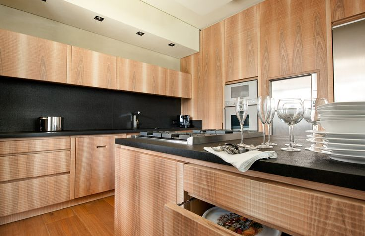 Wood kitchen with Zimbabwe black granite counter tops and island.  #Habito #GiuseppeRivadossi #Italy #design #kitchen #wood