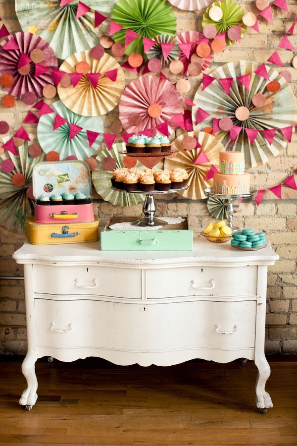 Bright paper decorations and a sweet table!   Wedding Theme Inspiration - Bright & Beautiful Vintage Travel   See more on You Mean The World To Me http://www.youmeantheworldtome.co.uk/wedding-theme-inspiration-bright-and-beautiful-vintage-travel/ Photography by Erin Johnson Photography