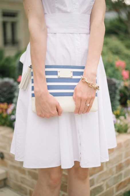 This striped Kate Spade clutch holds all your essentials and really pops against a white shirt dress.