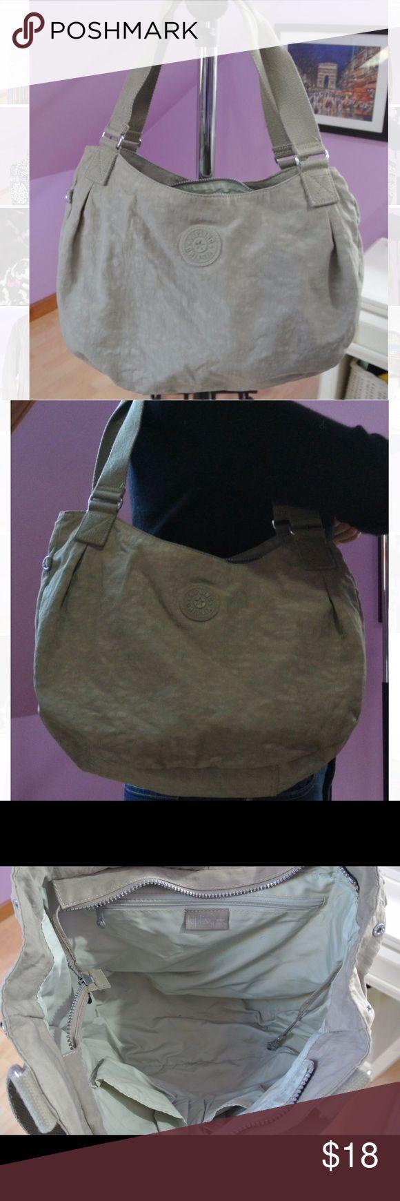 Kipling shoulder handbag Gently used Kipling shoulder handbag. Tan color. Very spacious. Can use it for school or as a gym bag. Kipling Bags Shoulder Bags