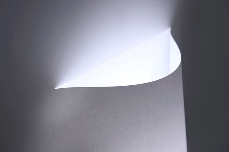 YOY design studio forms poster lamp with a single sheet of paper
