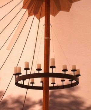 chandelier is slipped through tent pole  b4 it goes up - anchored to pole...
