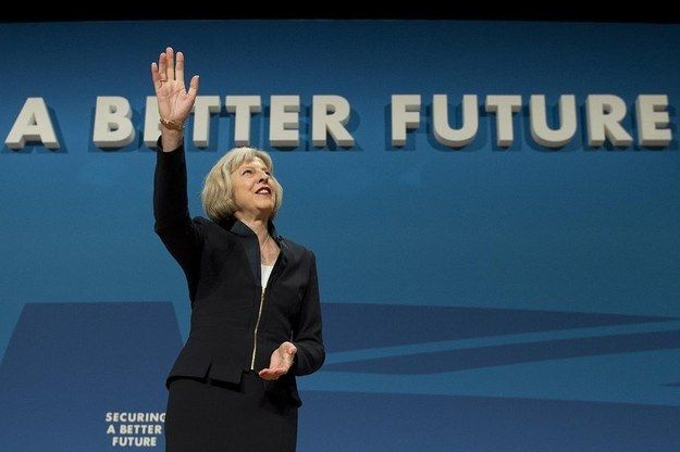 """Theresa May accidentally rewrote the Conservatives' """"A Better Future"""" slogan at their 2014 party conference.   13 Incredibly Awkward Pictures Of Politicians Standing In Front Of Unfortunate Signs"""