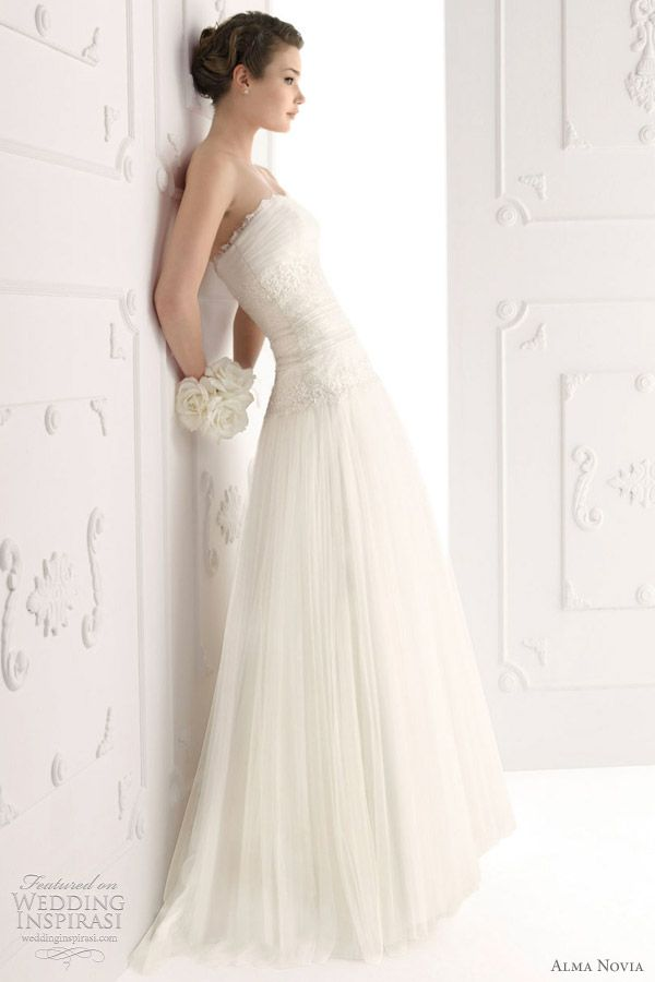 I love the pleated chiffon skirt--it flows, but it's not bulky or poofy.  alma novia wedding dresses 2012 bridal collection - Siglo