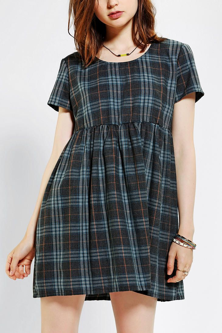 byCORPUS Plaid Babydoll Dress from UO, pair this with Saint Laurent combat boots and rock your inner punk style!