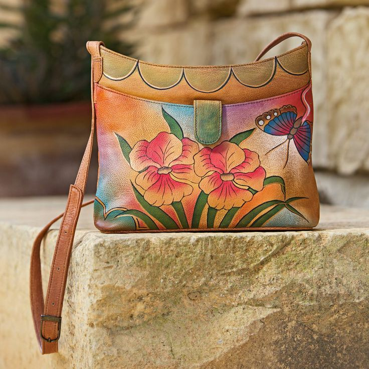 Colorful flowers and butterflies, inspired by Kolkata's formal Victoria Garden, decorate this soft and supple handbag. Victoria Garden Hand-painted Leather Bag | National Geographic Store