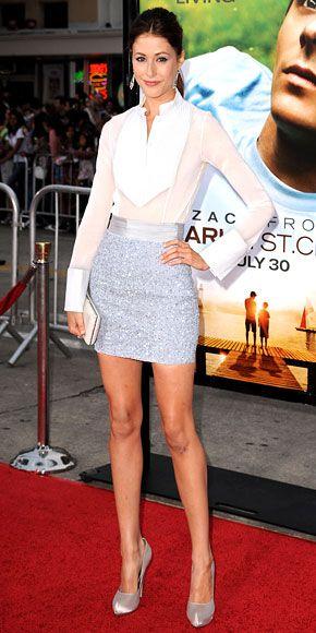 Amanda Crew in white tuxedo-inspired shirt, sequined mini, metallic pumps, and VBH clutch