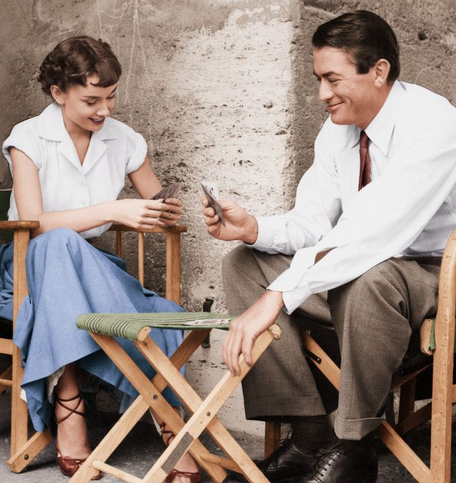 Audrey Hepburn playing cards with Gregory Peck in a scene fromRoman Holiday, 1953.