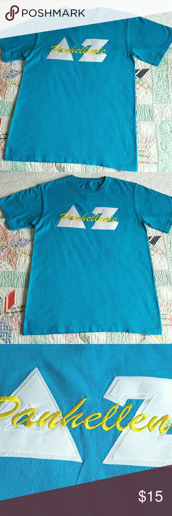 """Delta Zeta Sorority Letter T-Shirt Blue Size Small Practically brand new (worn once!) Bright blue Delta Zeta Sorority Letter T-Shirt.  Greek letters are white on white background with embroidered """"Panhellinic"""" across the front.   Letters meet DZ sorority t-shirt standards.   Tee by C Port and Company, 100% cotton. Round neck, short sleeve.  Super condition...no evidence of wear, no holes, stains or picks.  Freshly laundered and pressed.  Ready to wear! C.P. Company Tops Tees - Short Sleeve"""