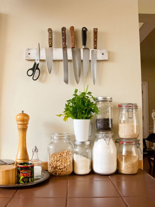 "Sneak Peek: Leah Lawrence & Billy Bartels. ""We have an open-style kitchen and pantry and Leah loves to put everything in jars. Billy made this wooden magnetic knife board."" #sneakpeek"