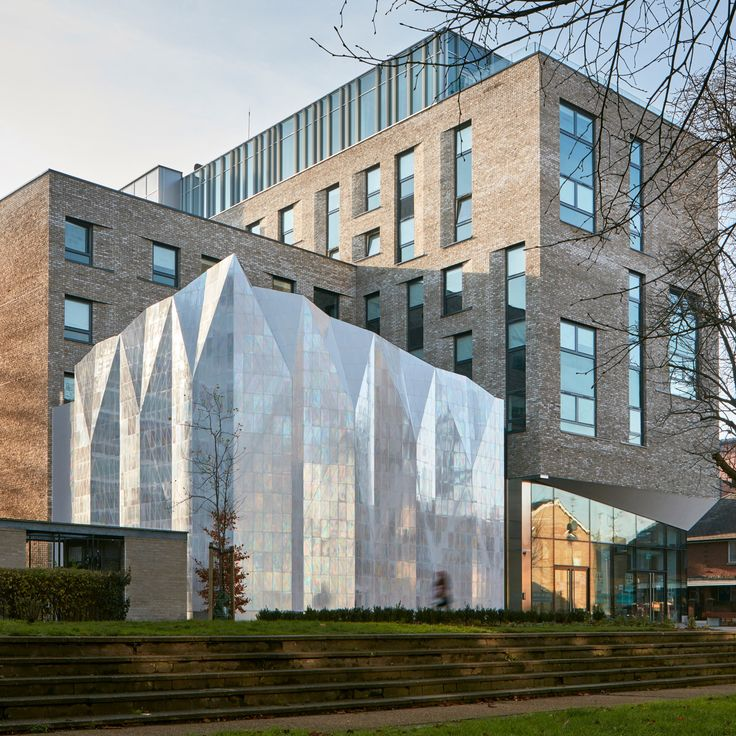Southwark Town Hall in south London has been renovated and repurposed to accommodate student housing and a mixed-use arts hub, including a theatre contained in a folded tile-clad extension.