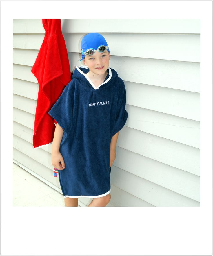 7 year old boy wearing medium size luxury hooded beach towel in Navy Blue.  www.nauticalmile.com.au
