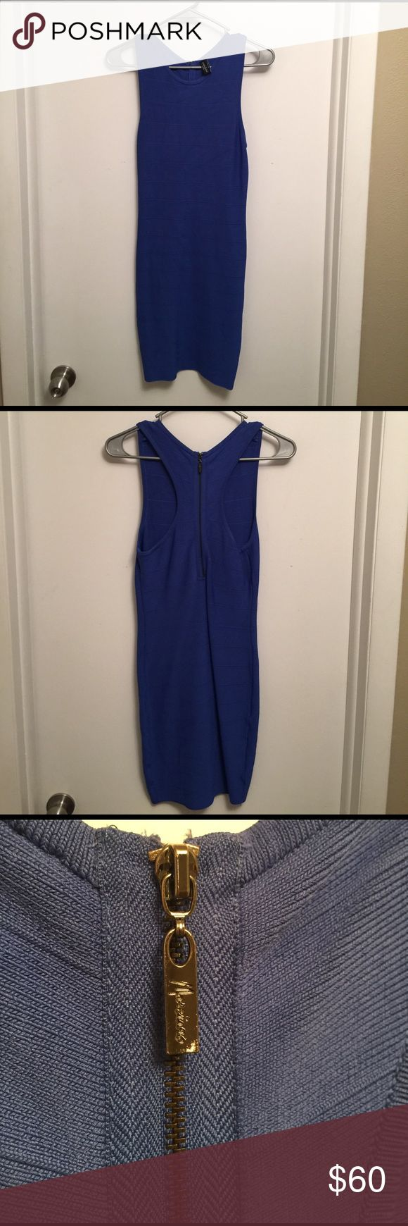 Guess by Marciano Blue bondage dress Blue Guess by Marciano bondage dress worn once. Guess by Marciano Dresses Mini