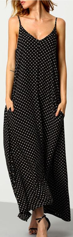 Beautiful long and flowy dress! Perfect size and perfect length. Only the straps were a little bit long, so I had to shorten them a bit. I love the rayon material and the fact it has pockets too! Black Braces Deep V Neck Floral Houndstooth Print Cami Slip Dress fromshein.com.