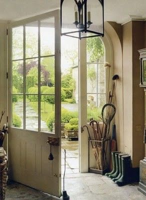 Love the umbrella stand with the lacrosse stick for the gap behind the front door