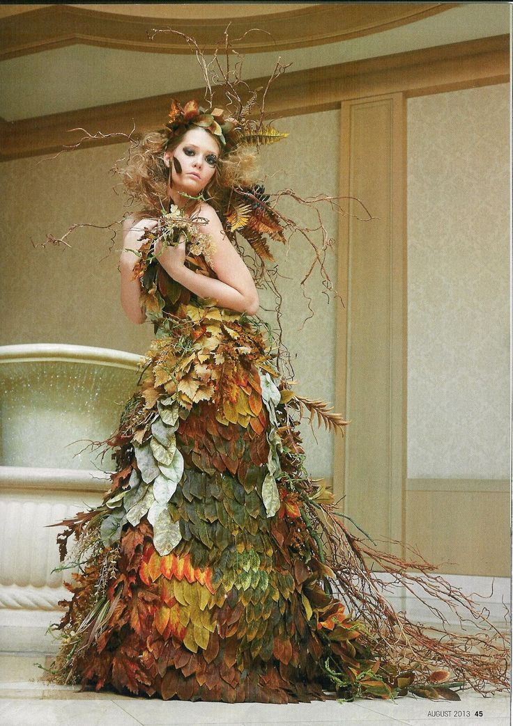 "Emma Star Floral: Las Vegas- ""Savage Botanicals"" Symposium -- ""Autumnal Ruination"" This gown features groupings of artificial leaves, branches, and grasses."