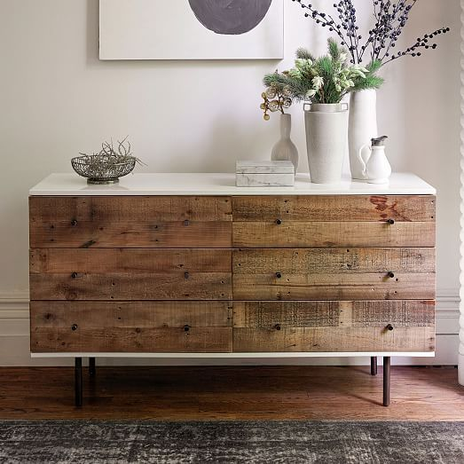"Rustic Lacquer Storage 6-Drawer Dresser, Reclaimed Pine, Gray Wash $1399  Best of both worlds. Town meets country on our Reclaimed Wood + Lacquer Dresser, framing rustic pine drawers in a sleek lacquer frame. The wood comes from solid pine shipping pallets, reinvented into unique storage pieces for the home.   58""w x 18""d x 33""h. Reclaimed pine wood drawers. Engineered wood case with glossy white lacquer finish. Brass plated drawer pulls and metal legs in Antiqued Bronze finish. Made in…"
