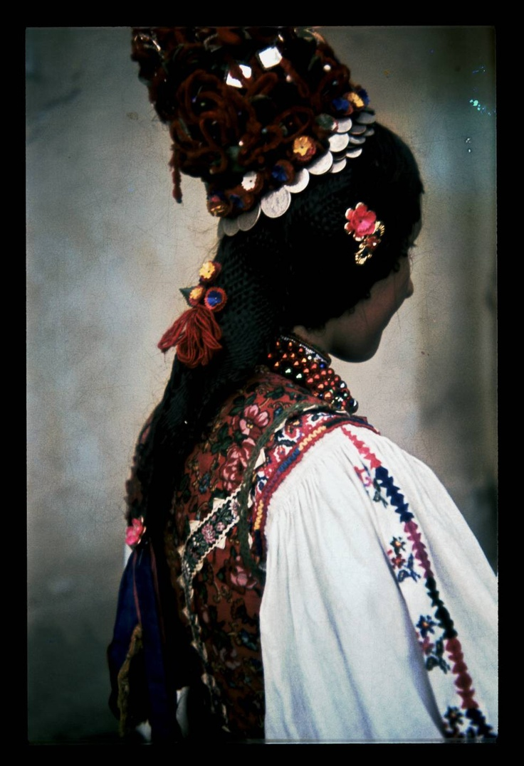 Europe | The back of a woman wearing traditional clothes, Avasújfalu, Hungary