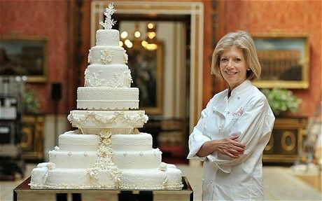 The official cake, designed by Fiona Cairns, pictured, was made from 17 individual fruit cakes and decorated with cream and white icing