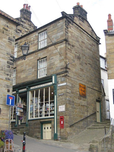 George V post box , Robin Hoods Bay-located in King Street is this Grade II listed house with shop, dating from the early to mid 1800s. Built from sandstone of near-ashlar quality with a Welsh slate roof.