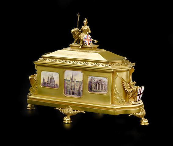 An Important George V 18K yellow gold London Freedom Casket by Mappin & Webb, Sheffield, 1926 Of coffer form, the hinged lid surmounted with Britannia holding a shield with the Union Flag before a lion, over a dedication inscription to Walter S. Monroe dated 19th November 1926, the case inset with enamel plaques of St. Paul's Cathedral, Houses of Parliament, Royal Exchange, Central Criminal Court of England and Wales 'Old Bailey' and Tower Bridge, center verso applied with the coat-of-arms