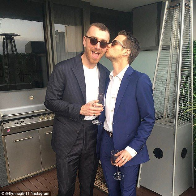 'A few of my favourite things from 2017': Brandon Flynn (R), 24, took to Instagram on Monday, posting a heartfelt tribute to boyfriend Sam Smith (L) 25, as the pair rang in the New Year in Sydney