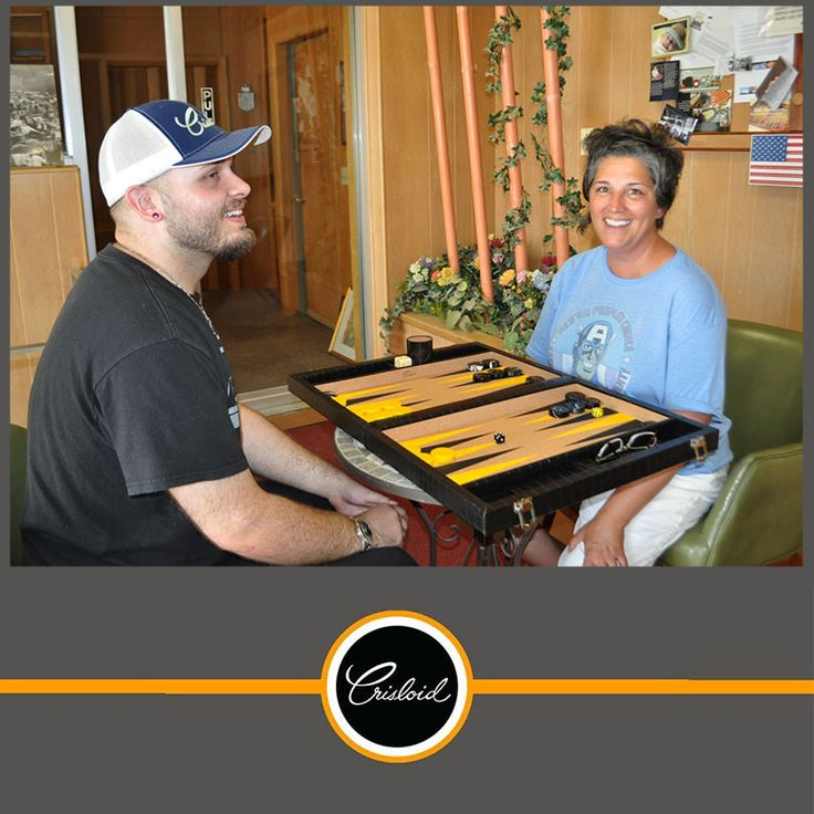 Zach and Marci playing a game of Backgammon at Crisloid. #happygame