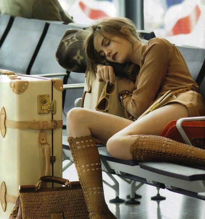 Napping at the airport (with Globetrotter suitcase in tow)