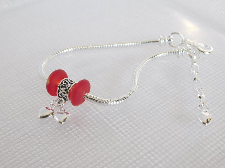 A personal favorite from my Etsy shop https://www.etsy.com/listing/586020473/two-hearts-bracelet-heart-charm-bracelet