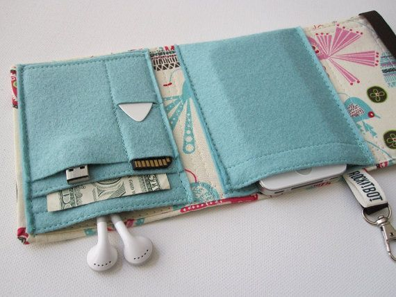 A homemade wallet for gadgets, cards and cash.  This would be an awesome idea to try to make my own custom gadget wallet.