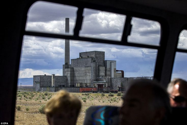 Above, a bus tour sees Washington's Hanford Site, which was developed by the government to...