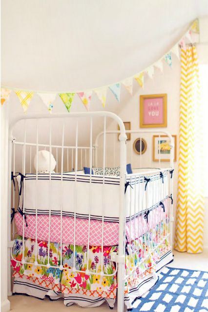 I love all the textiles in this room.......................and I know that cot bumpers aren't safe, but this cot would still be great without it.