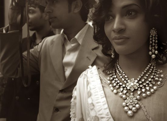 Jadau kundan enamel three-line necklace and earrings studded with large uncut…
