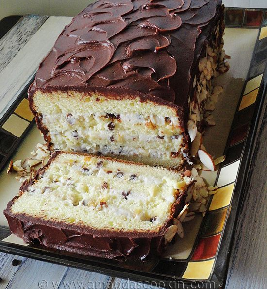 Cassata Cake - the cassata siciliana consists of round sponge cake moistened with fruit juices or liqueur and layered with ricotta cheese, candied peel, and a chocolate or vanilla filling similar to cannoli cream