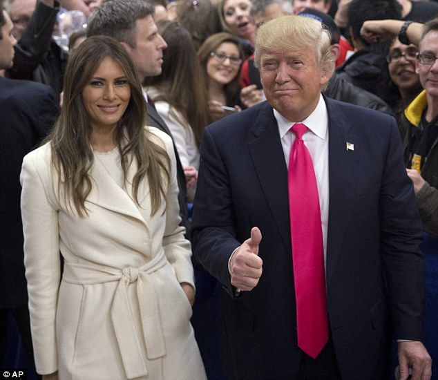 Donald Trump gives a thumbs up as he and wife Melania pause for photos in Council Bluffs, Iowa, on Sunday