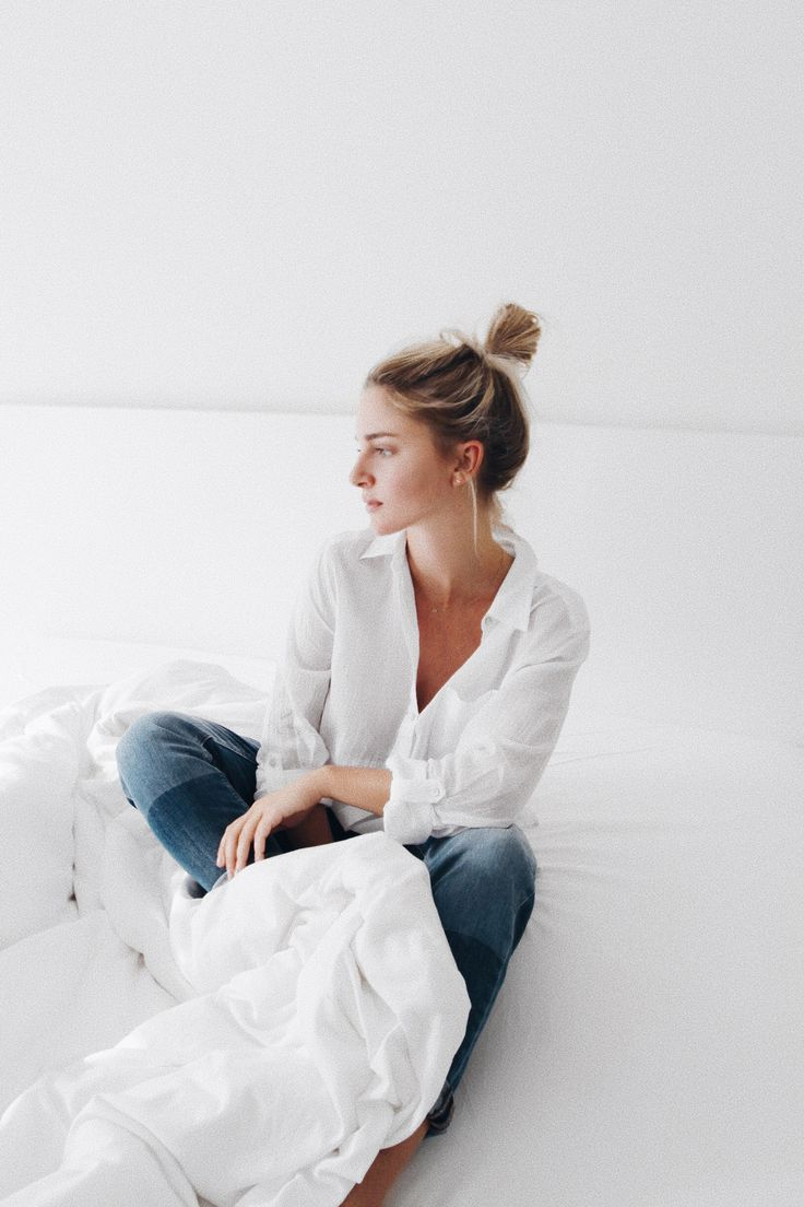 MESSY TOP KNOT AND WHITE SHEETS