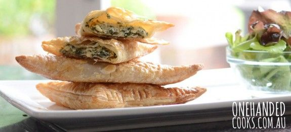 Ricotta, Spinach and Pinenut PastriesIngredients1 tsp extra virgin olive oil1 onion , finely chopped1/2 cup (60g) frozen spinach, thawed and drainedPinch of nutmeg1/2 cup ricotta1/4 cup grated parmesan cheese1 tsp lemon3 tbsp pine nuts, crushed2 sheets puff pastry1 egg, whisked