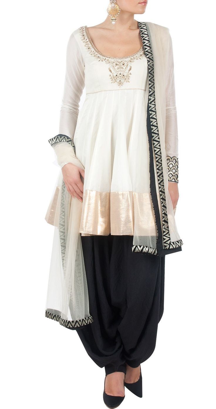 PAYAL SINGHAL - Off white and black kurta set with gold border http://www.perniaspopupshop.com/