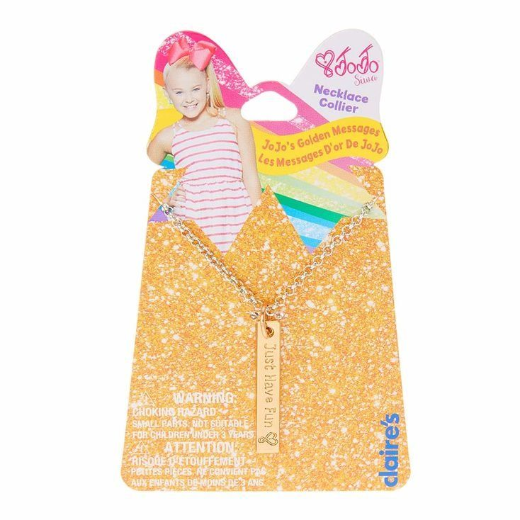 "Show the world you are JoJo Siwa's Number One Fan with this adorable gold pendant message necklace from the JoJo Siwa Collection. The gold pendant is engraved with ""Just Have Fun"" and the signature JoJo Siwa heart. Pendant is attached to a silver chain with a lobster clasp."