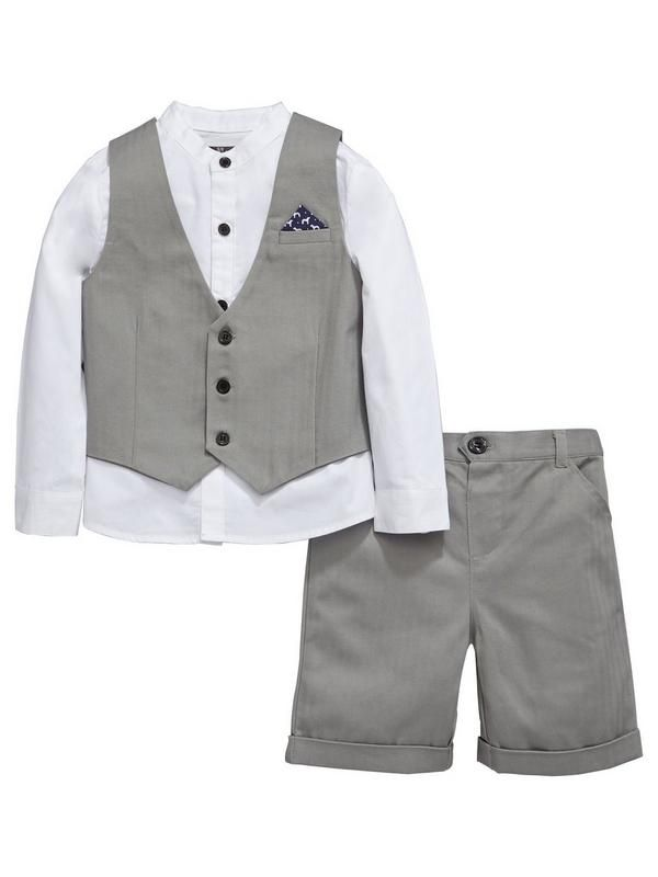 Mini V by Very 3 Piece Boys Grey Herringbone Shirt, Waistcoat and Shorts Set Perfect for summer occasions, this little boys shirt, waistcoat and shorts set from Mini V by Very is a cool choice. The white long sleeved shirt boasts a dapper grandad collar, while the coordinating grey waistcoat and shorts feature classic herringbone patterns. A pocket square and turn-ups add smart style, while an elasticated waist ensures all-day comfort. Styling Ideas All he needs is a pair of smart loafers to…