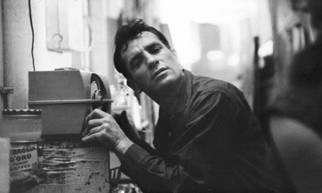 Jack Kerouac leans closer to a radio to hear himself on 1959 broadcast