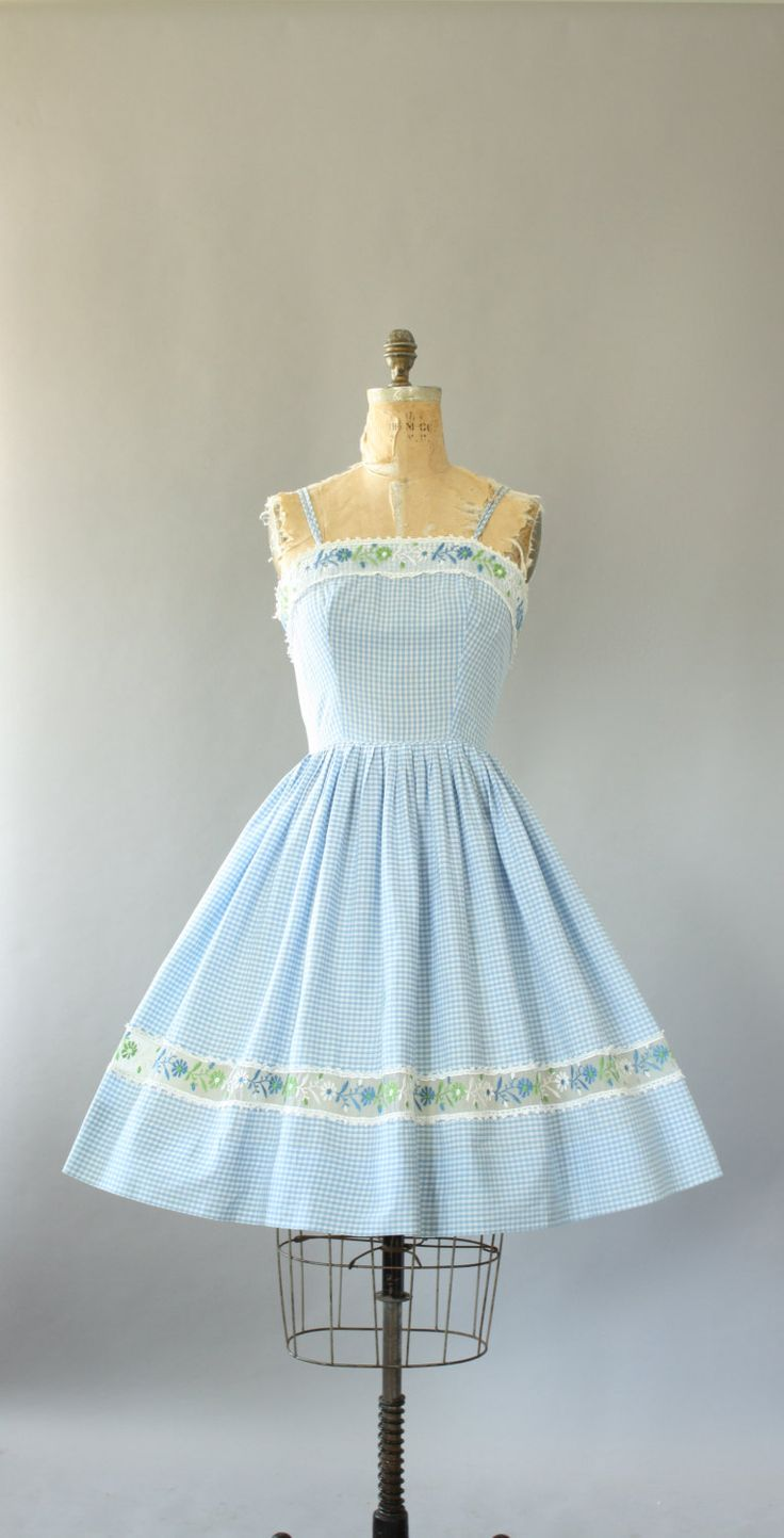 Vintage 50s/early 60s light blue gingham print cotton sundress. Sheer fabric with floral embroidery on neckline and skirt. That sheer fabric
