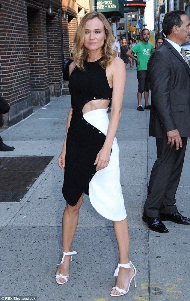 Poised: The blonde beauty opted for white sandal heels, adorned with a bow around her ankle, as she cut a petite figure