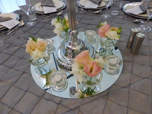 Love the mix of flowers and candles and these votives are just perfect.  http://www.tailracecentre.com.au/weddings/