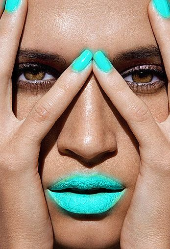 Striking use of turquoise nail polish and lipstick against gorgeous brown eyes! #makeup #beauty