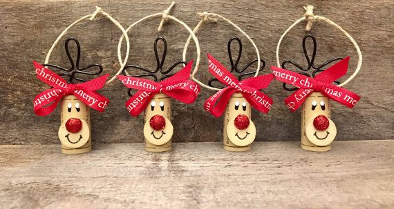 Set of 4 adorable wine cork reindeer ornaments. These can be used to decorate your tree or given as a gift. Wine lovers will go crazy over this little cork reindeer. Perfect and totally unique hostess or Yankee Swap gift for all those parties youll be attending during the holiday season. This decoration was made with loving thoughts of Rudolph. Their red glitter noses make them pop with Christmas spirit! Add these reindeer ornaments to your gift packages or cookie swaps for a loving handmade…