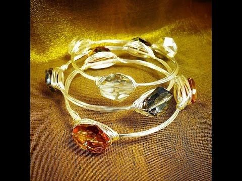 The Bead Place's Abbi Berta shows you how to wire wrap a beaded bangle bracelet! Using a cup, 24 or 22 ga. wire, and three crystal beads, you can make a fant...